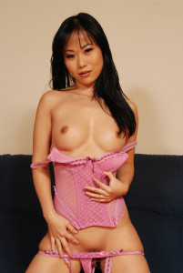 Asian babe exposes her tits